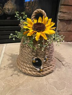 """This beehive decor is the perfect addition and final touch to all your spring decor. This beehive is hand made and one of a kind. This beehive is perfect for all honey or bee decor. Approximately 9.5"""" tall (including top loop) 7"""" wide Greenery embellishments and sunflower add the final touches to Valentines Day Decorations, Spring Decorations, Table Decorations, Bee Crafts, Hand Crafts, Tree Topper Bow, Bee Skep, Diy Crafts Hacks, Dollar Store Crafts"""