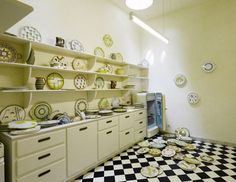 """Part of the installation""""The Collectors"""" by Eastman & Dragset at the 2009 Venice Biennale, a kitchen housing an eerily disturbed collection of Weimer-like plates tells a tale of turbulent family relationships."""