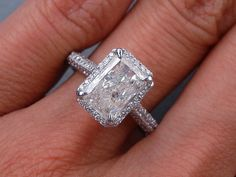 The Rad: 2.12 ctw Radiant Cut Diamond Engagement Ring. It has a glamorous 1.53 ct I color/I1 clarity, Radiant Cut center diamond. Set in a beautifully designed 14k White Gold setting, this ring is listed for $4,990