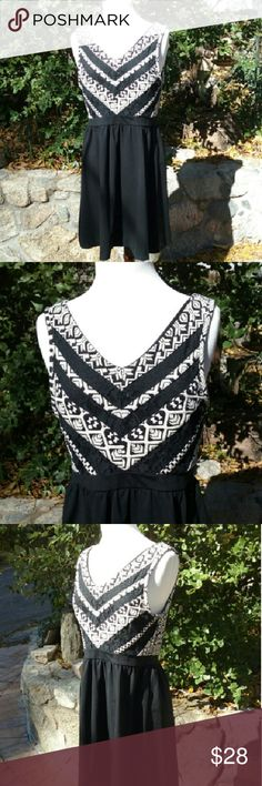 Cynthia Rowley  fit and flare dress Super cute little Cynthia Rowley size large black and slight off white fit and flare dress. The bodice has a cute geometric print with lace cutouts, fully lined no issues, ready to wear Cynthia Rowley Dresses Mini