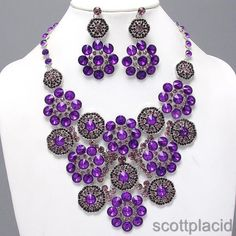 "CHUNKY PURPLE FLOWER THEME SILVER TONE NECKLACE SET WITH CRYSTAL AND ACRYLIC ACCENTS $44.99    * If you need a necklace extender I have them for sale in my store.*          NECKLACE: 14 1/2"" L + EXT    DROP: 4 1/4"" LONG    POST EARRINGS: 2 3/4"" LONG                 COLOR: SILVER TONE"