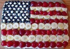 Fourth of July fruit pizza - sugar cookie base, strawberries bananas and blueberries for red white and blue with a cream cheese frosting. mmm