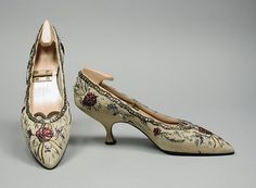 Pair of Woman's Pumps  House of Dior (France, Paris, founded 1946)  Roger Vivier (France, Paris, 1913-1998)  France, 1957  Costumes; Accessories  Silk faille, leather, silk and metallic threads, rhinestones  Size: 7 1/2  Gift of Mrs. Deane Johnson (M.75.99.8a-b)  Costume and Textiles