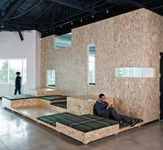 Particle board partition walls and raised lounge surfaces.