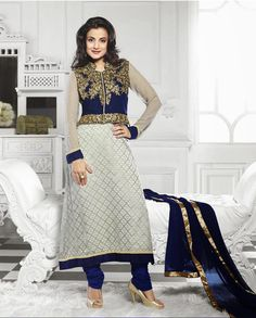 White and blue jacket style long suit   1. White and blue embroidered brasso suit 2. Golden embroidered jacket style yoke3. Blue and golden border4. Comes with matching bottom and dupatta5. Can be stitched upto size 42 inches