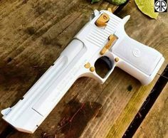 She is a Beauty White Cal Desert Eagle I want a pair! One white one black! Ninja Weapons, Weapons Guns, Guns And Ammo, Airsoft, Hand Cannon, Armas Ninja, Desert Eagle, Custom Guns, Cool Guns