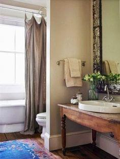 "Rustic bathroom.  Interesting shower ""curtain"""