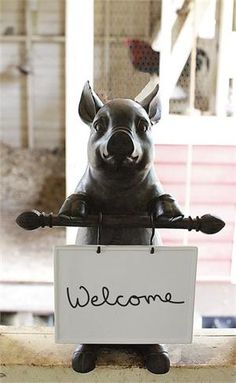 Let this adorable swine sign add a bit of wit to your country farmhouse decor. The Country Pig Message Board makes a great kitchen helper and is perfect for welcoming guests, displaying your dinner menu at your next party, or for just leaving daily reminders for the family. Made of cast resin with a rustic finish, this farmyard friend holds a ceramic dry erase board, which hangs from two S hooks.