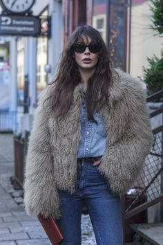 Double denim, fur, sunnies, good hair.