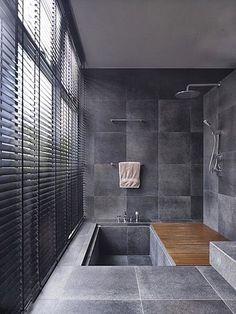 Sunken bath tub, natural stone flooring, dark grey tiles - this bathroom is somewhere we'd love to have a long soak in! Bad Inspiration, Bathroom Inspiration, Bathroom Ideas, Bathroom Vanities, Bathroom Remodeling, Remodeling Ideas, Remodel Bathroom, Shower Ideas, Bathroom Inspo