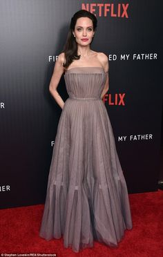 Classic: The stunning grey dress first cinched in at her famously slender waist, before falling into soft pleats all the way to the floor