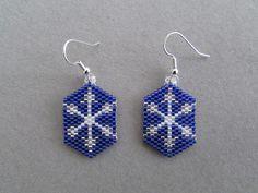 Snowflake Earrings by DsBeadedCrochetedEtc on Etsy https://www.etsy.com/listing/478251813/snowflake-earrings