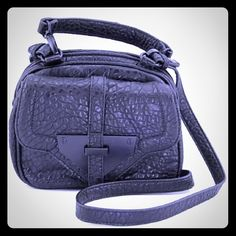 """STEVE MADDEN Black vegan leather messenger-BEAUTY CONDITION: New with tags BRAND/STYLE: Steve Madden Bspyy COLOR: Black MATERIAL: Faux Leather DIMENSIONS: 8"""" W x 7"""" H x 3.5"""" D SHOULDER STRAP DROP: 23.0 in. SKU: 2152527 Carry your belongings with ease in the Bspyy bag from Steve Madden. Made of quality Faux Leather materials, this will keep your essentials on-hand with great style. Manufacturers packaging. Steve Madden Bags Crossbody Bags"""