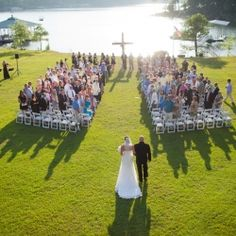 Beautiful backyard lake wedding in sweet home Alabama.  **Love the outdoor wedding and lake with the *cross at the end of the aisle
