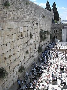 The Western Wall, a remnant of the ancient wall that surrounded the Temple Mount in Jerusalem. Herod the Great is believed to have started building it around 19 BCE. The wall goes far below street level and many sections of the Western Wall are concealed behind structures running along the whole length of the Temple Mount. There is just a small portion that remains and is still visible.