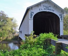 The Offutt's Ford Covered Bridge, Rush County, Indiana, was built by the members of the Kennedy family in 1884. The Kennedy family built covered bridges in the region for three generations. (V)