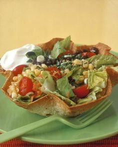 "Taco Salad | Martha Stewart Living - It would be easy to believe that taco salads were invented by kids. They're just as yummy as traditional tacos, but everything is tossed in a crunchy ""bowl"" that you can eat."