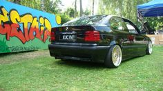 Rear view of a bmw e36 compact on OEM bmw bbs styling 5 (bbs rc) wheels