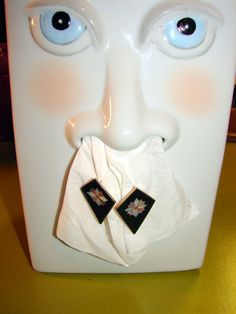 A nose Kleenex holder. This may beat the crocheted doll toilet paper cover.
