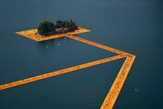 The Floating Piers, a site-specific installation by artists Christo and Jeanne-Claude. Meant to connect the village of Sulzano with the Monte Isola island and the small isle of San Paolo, this 5.5-kilometre-long network of corridors floats on water for 3 kilometres with support from polyethylene cubes.