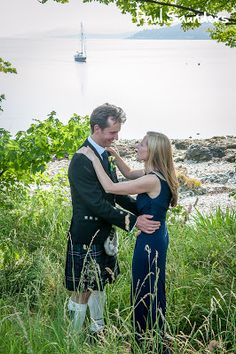 A romantic moment on the banks of Loch Long, just after getting married at Knockderry Country House Hotel.