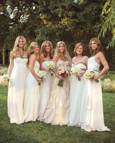 These ladies all wore custom made cream-colored gowns to complement the bride's dress