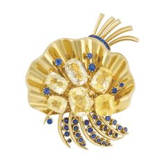 Gold, Yellow Sapphire and Sapphire Flower Clip, Van Cleef & Arpels The fluted flower centering 6 cushion-shaped yellow sapphires, enhanced by 6 round sapphires, topped by a polished gold wire spray cinched by 6 rectangular-cut sapphires, accented by polished gold sprays edged by 25 round sapphires, signed Van Cleef & Arpels, N.Y., no. 16835, circa 1940, approximately 33 dwts.