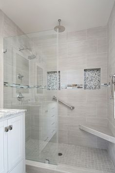 This stunning shower has two tiled niches because two is always better than one! This La Jolla bathroom remodel was renovated as part of a whole house remodel. Photos by PreviewFirst