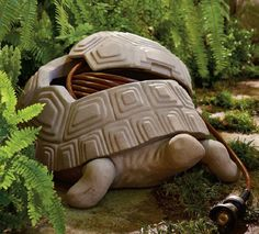 This decorative turtle pot is crafted from all-weather faux stone and hides up to 100 feet of half inch garden hose beneath its shell.