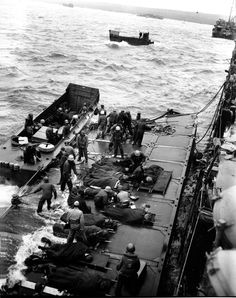 U.S. Marines wounded at the beach of Iwo Jima are evacuated on pontoon barges by hospital corpsmen on Feb. 27, 1945. They will be taken to an LST standing by for transfer to hospital ships. (AP Photo/Joe Rosenthal) #