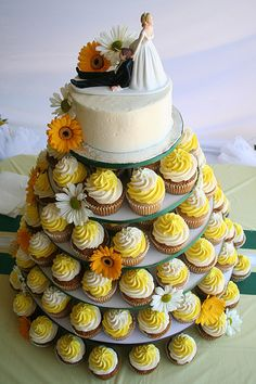 Love the cake topper! And the flowers around the cupcakes...cute