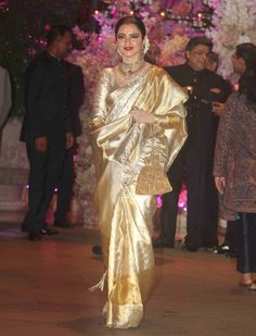 Rekha in shimmering gold Rekha Saree, Bollywood Saree, Indian Bridal Outfits, Indian Bridal Fashion, Golden Saree, Kota Silk Saree, Wedding Saree Collection, Traditional Silk Saree, Telugu Brides