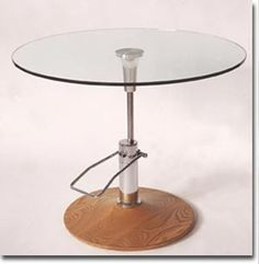 It's a hydraulic table. Nifty! (Yep, I used the word nifty. I'm bringing it back.) :-)