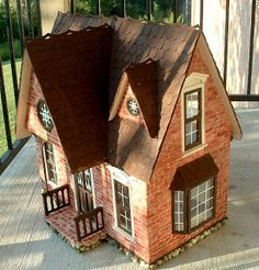 The Orchid Dollhouse done in exterior brick finish.