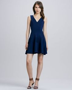 Feminine and figure flattering. Sleeveless+Seamed+Fit-and-Flare+Dress+by+Robbi+%26+Nikki+at+Neiman+Marcus.