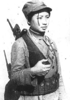 Female Chinese guerilla fighter armed with a Mauser C96 handgun, circa 1939