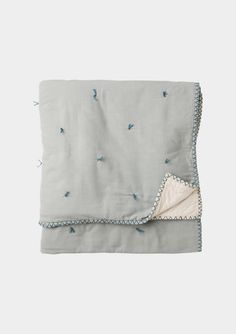 Make it OLD:  Washed cotton bedspread with contrast handstitched edging. Decorated with a traditional quilting method. Light cotton wadding fill. Backed in plain cotton voile.