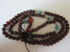 Mala made of carnelian beads carved to look like flower buds, and crystal and turquoise beads, 19th century