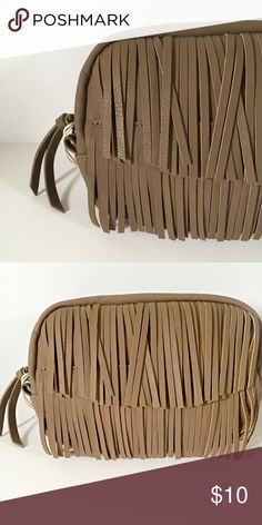 Taupe Travel Pouch With Fringe The Women's Travel Pouch in taupe fringe from Mossimo Supply Co is perfectly sized to fit your everyday essentials and ready to be chicly carried under your arm. Featuring a chic exterior and a full zip closure, this bag will be your new go-to. For use as a wallet, just toss this pouch in your larger bag. 3 H X 6 W X 9 D Mossimo Supply Co Bags Travel Bags