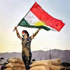 Kurdistan flag flying high above everyone's head.