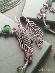 Pandora feather earrings.