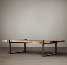 RH's Reclaimed Pine and Steel Clamp Coffee Table:A substantial clasp table that once supported the efforts of 20th-century industry was the prototype for our reproduction. Steel clasps secure a broad top constructed by hand of salvaged, reclaimed solid pine planks.