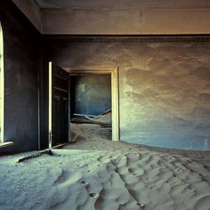 In Namibia, Africa, the ghost town Kolmanskop is slowly sinking, being buried by sand to be trapped in time. Photo by Michiel Van Balen.  Posted by Florence Fontaine.