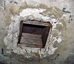 auschwitz celling hole were the nazi leaders dropped the gas into the gas chamber to kill everyone that was inside of it