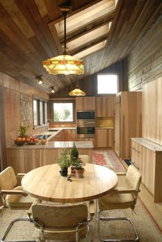Rustic Wooden Kitchen. Beautiful kitchen with wall to wall wood including custom cabinets. mistyleighphotography
