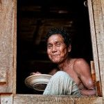 Happiness often sneaks in through the window you didn't know you left open. This shot was taken at a Bandarbans, Bangladesh. The man in this shot is an aboriginal. I took this shot on his house yard at noon when he was having his lunch.