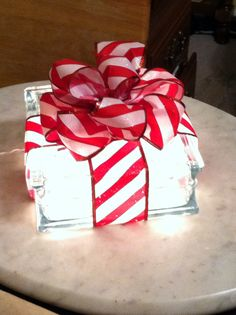 a glass block filled with christmas lights and topped with a bow this was simple