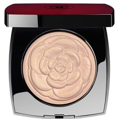 PRODUCT Artfully embossed with the iconic Chanel camellia, a sheer highlighting powder captures and reflects light for a delicate, luminous glow. In a rare, limited-edition red case and accompanied by a half-moon brush for easy, optimal application.HOW TO APPLYUse the accompanying brush to lightly dust CAMÉLIA DE CHANEL highlighting powder over the cheekbones and the high points of the face.