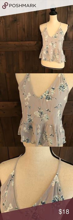 "UO KIMCHI BLUE Floral Peplum Tank EUC.   Spaghetti straps, loose fit with peplum detail at waist, delicate floral pattern.   100% rayon  Chest: 18"" flat across Length: 19.5""-21"" Urban Outfitters Tops Tank Tops"