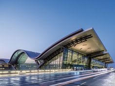 Hamad International Airport Passenger Terminal Complex / HOK Completed in 600000 in Doha Qatar. Images by Tim Griffith Hamad International Airport, Richard Rogers, Building Silhouette, Airport Design, National Airlines, Wallpaper Magazine, Facade, Architecture Design, Amazing Architecture